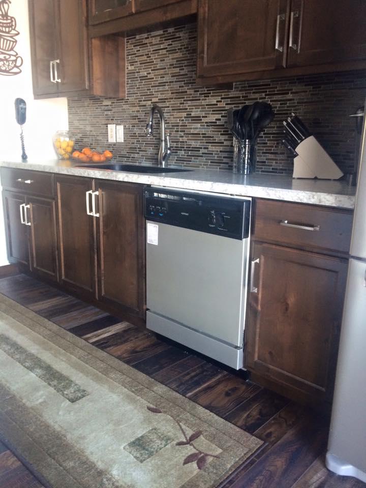 Rustic Alder Kitchen Cabinets with Mission Oak Stain and a Tile Backsplash